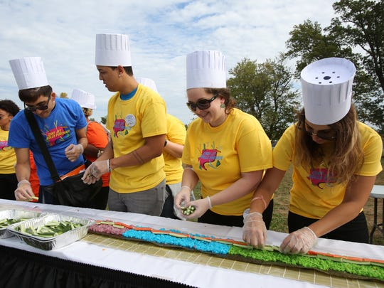Purchase College students assemble the rainbow portion