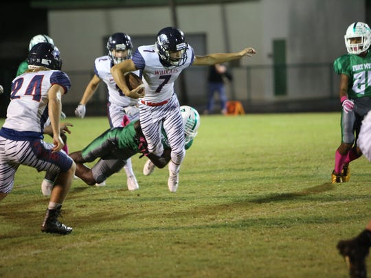Fort Myers played host to Estero for its homecoming game. Estero's Jesse Vail runs after a catch.