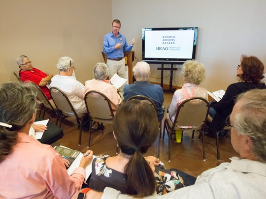 Dennis Daily, with NMSU Library talks with a group on Saturday, October 14, 2017, during the 2017 Border Archives Bazaar at the Southern New Mexico Farm & Ranch Heritage Museum.