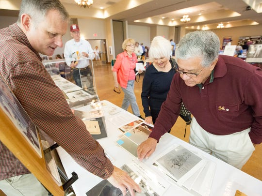 Juan Jaquez, right and his wife Pat look at images from the White Sands Missile Range museum on Saturday, October 14, 2017, during the 2017 Border Archives Bazaar at the Southern New Mexico Farm & Ranch Heritage Museum. Talking with the couple about the images is museum director Darren Court.