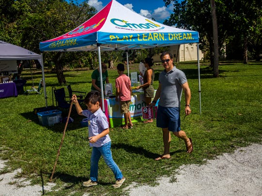 Kids and parents explore booths during a child empowerment day at the Koreshan State Historic Site on Sunday, Oct. 15, 2017.