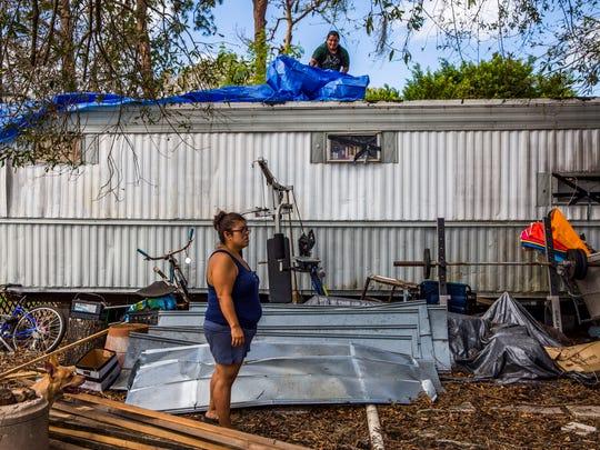 Samantha Tindell stands outside her damaged Immokalee