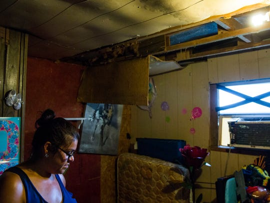 Samantha Tindell in a room in her home with damage to the ceiling and mold in her Immokalee trailer on Friday, Sept. 22, 2017. Despite the fact that part of their trailer's ceiling is collapsing and there is mold in one the rooms, FEMA said they are ineligible for housing assistance, because Hurricane Irma didn't make their home unsafe to continue living in.