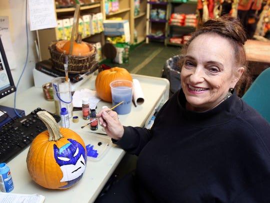 "Joanna ""Ginger"" Cardilli paints Batman on a pumpkin"