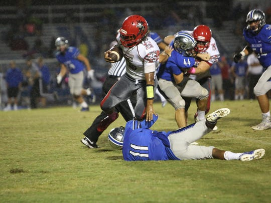 Scenes from North Fort Myers at Ida Baker on Friday, Oct. 20. Fa'Najae Gotay runs through a tackle.