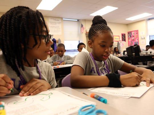 Fifth-graders Bryana Bennett and Ariela Osborne work