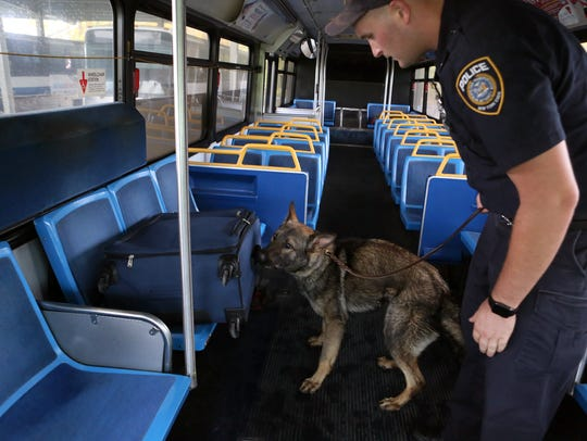MTA Police Officer Charlie Spahr and his teammate Hoss,