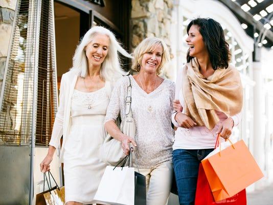 Trio of Beautiful mature women shopping