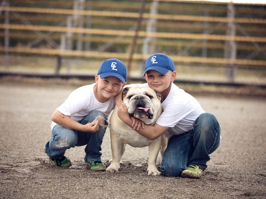 Beau and Charlie Denton pictured with their dog. Charlie, 9, was was born with neurocutaneous melanosis. In July 2016, it was found he had multiple tumors around his spine. The 9-year-old was left paralyzed following one of several surgeries.