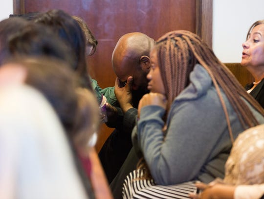 Mackindy Dieu, brother of Guerline Dieu Damas, is overcome with emotion Friday, Oct. 27, 2017, after Collier Circuit Judge Christine Greider sentenced Guerline's husband, Mesac Damas, to death. Mesac Damas had pleaded guilty to murdering Guerline and their five children in September 2009 in their North Naples home.