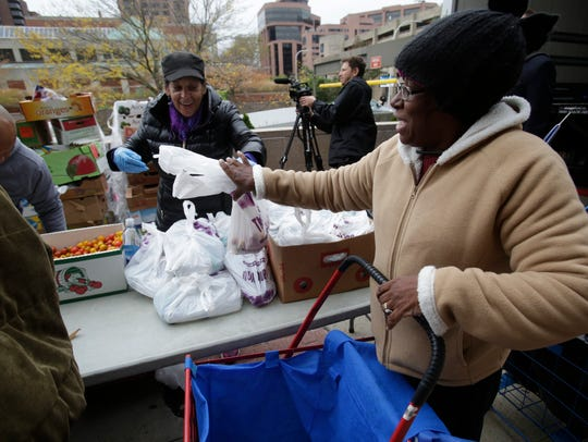Joyce Thomas of White Plains receives some food at