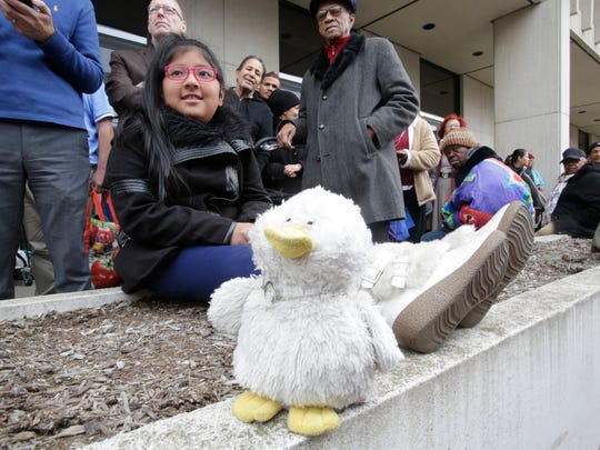 Alissa Jadan, 9, of White Plains waits with her family