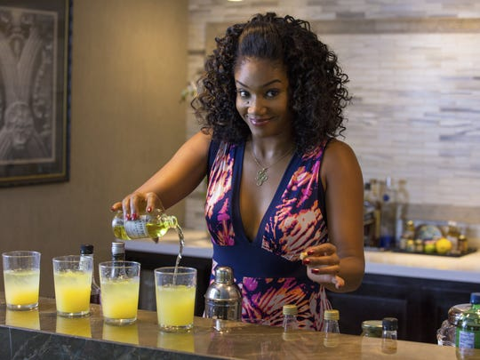 "This image released by Universal Pictures shows Tiffany Haddish in a scene from the comedy ""Girls Trip."" (Michele K. Short/Universal Pictures via AP)"