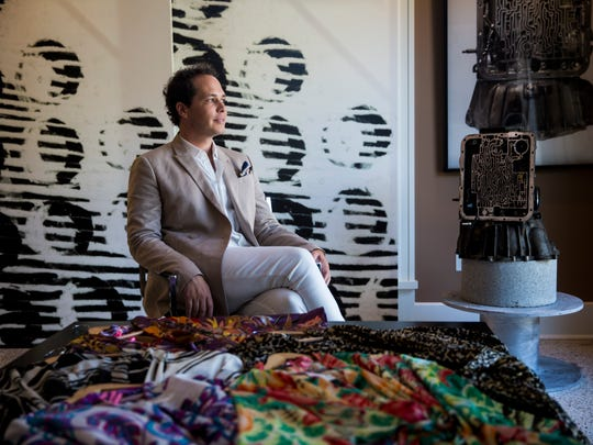 Southwest Florida fashion designer Galen Magee sits