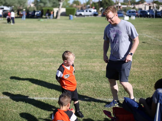 Desert Flipper TV host Eric Bennett coaches his son Roman's soccer team at Demuth Park in Palm Springs on Saturday, October 28, 2017.
