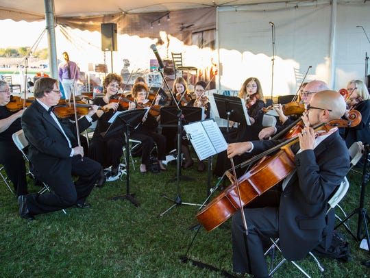 Members from the Phoenix Symphony performs at the Bentley