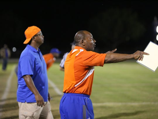 Scenes from the Cape Coral at Mariner high school football game on Nov. 3. Seahawks coach Larry Gary works the sidelines.