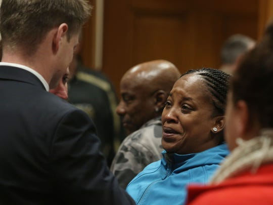 "An emotional Katrina Johnson meets with Assistant U.S. Attorney Chris Perras  after the jury returned a guilty verdict in Jorge ""Lumni"" Sanders-Galvez's first-degree murder trial, Friday Nov. 3, 2017 at the South Lee County Courthouse in Keokuk, Iowa. Sanders-Galvez was one of two men accused of killing Johnson's son Kedarie Johnson, 16, of Burlington, Iowa."