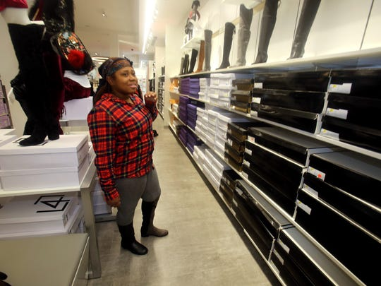 Melissa Lamar-Vanterpool of the Bronx shops for boots at Century 21, located at the Mall at Cross County in Yonkers Nov. 3, 2017.