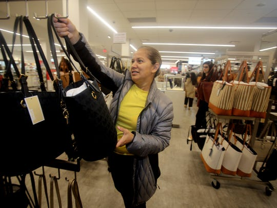 Madeleyne Lucero shops for handbags at Century 21,