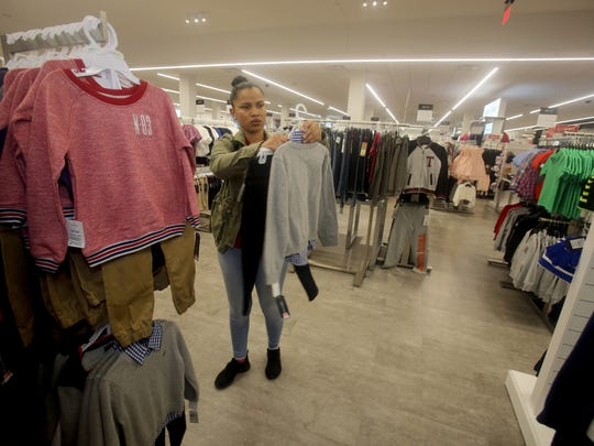 Pamela Vega of Yonkers shops at Century 21, located at the Mall at Cross County in Yonkers Nov. 3, 2017.
