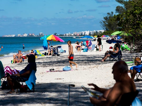 Beachgoers enjoy a day of sun at Delnor-Wiggins Pass State Park in North Naples on Saturday, Nov. 4, 2017.