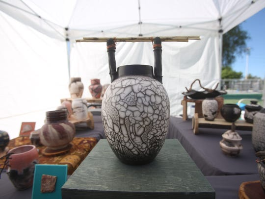 Teri Hudson displays her potter at the Civic Center