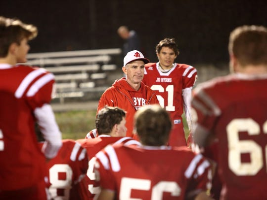 Jo Byrns coach Tom Adkins addreses his team after the