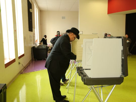 Coleman Young II casts his vote Tuesday, Nov. 7.
