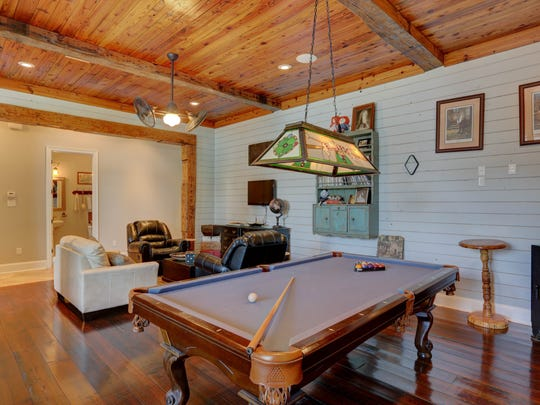 The is a large living/game room upstairs.