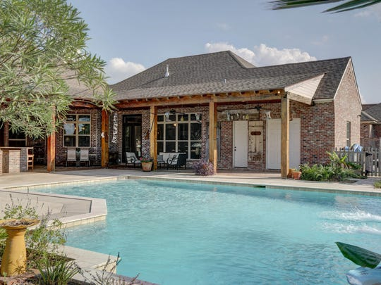 The sparkling pool is an oasis in the backyard.