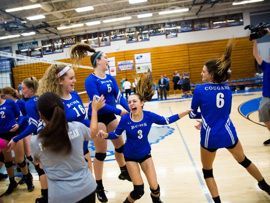 The Barron Collier volley ball team celebrates after their win on Tuesday, November 7, 2017 during the 7A regional final game against Port Charlotte at Barron Collier High School.