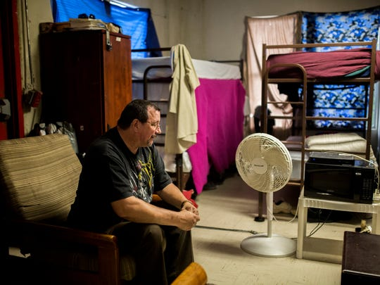 Clifton Armour, 50, talks about how he became homeless as he sits in his room at the Salvation Army on Friday, Nov. 3, 2017.