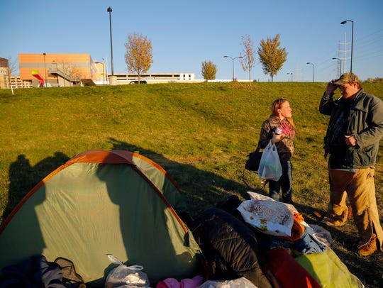 Tiffany Rice and Josh Comer set up a tent next to the