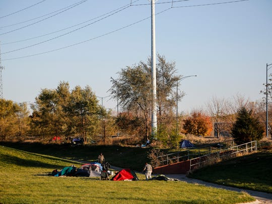 Homeless setup tents next to the Central Iowa Shelter