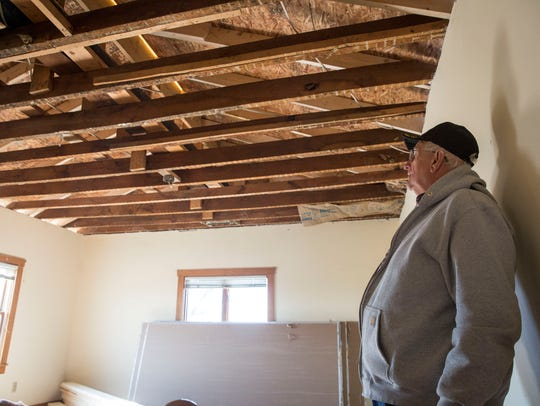 Jay County Commissioner Mike Leonhard surveys his ceiling