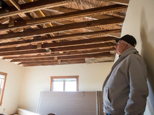 Jay County Commissioner Mike Leonhard surveys his ceiling joists in his home along East 300 North on Nov. 9 following a tornado that devastated the area. Over 56 homes in Jay County were affected by the storm with 11 homes being destroyed.
