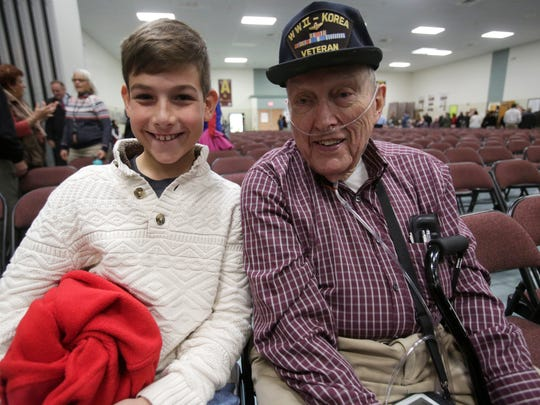 Ward Miller of LaGrange, a Air Corp veteran in WWII then a Army veteran in Korea, with his neighbor Zach Herman, 11, at the Union Vale Middle School in LaGrangeville  Veterans Day event on Nov. 9, 2017.