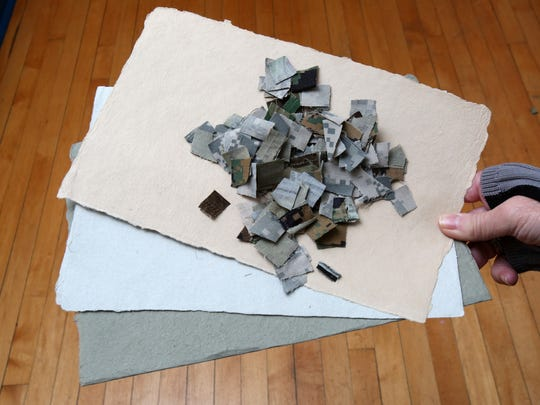 Combat paper is made from cut-up pieces of military uniforms. A display of art on combat paper, commissioned by Nyack Art Walk founder Paulette Ross, is on display upstairs at Nyack Village Hall.
