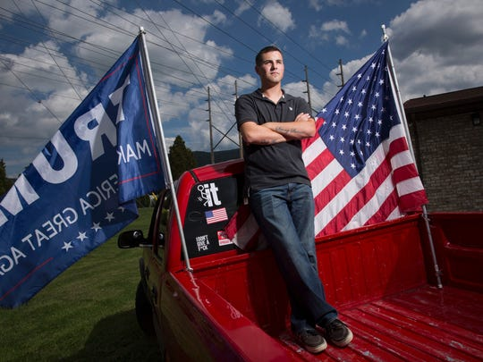 Ben Hornberger, a former Marine and volunteer for Donald Trump, poses for a portrait with his pickup truck September 8, 2016, in Altoona, Pennsylvania.