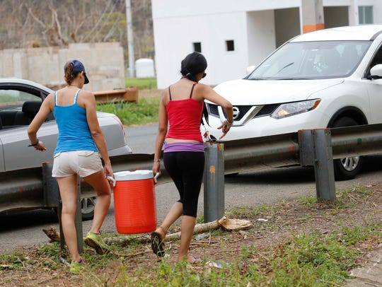 Michelle Rebollo and her daughter Nicole load up their