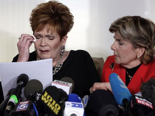 Beverly Young Nelson, left, the latest accuser of Alabama Republican Roy Moore, reads her statement as attorney Gloria Allred looks on, at a news conference, in New York.