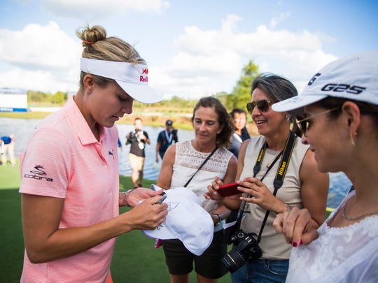 Lexi Thompson signs autographs during the official Pro-Am round on Tuesday, November 14, 2017 at the Tiburón Golf Club in Naples.