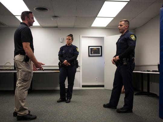 Officer Braden Tackett (from left), critiques cadets Dana Robbins and Cory Ricci after their de-escalation exercise on Tuesday, Nov. 14, 2017, at Corpus Christi Police Academy. Cadets in the academy are trained in crisis intervention and de-escalation.