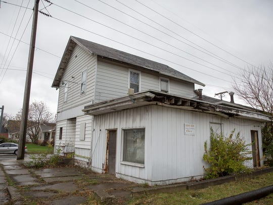 A worn down structure at 825 E. Memorial Dr. is one of 54 properties that is being sought for demolition with the city's blight removal effort. So far the city has seen 81 properties demolished.