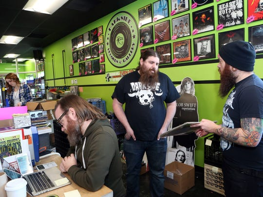 Darkside Records co-owner Justin Johnson, second right,