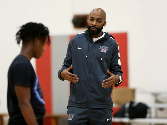 November 14, 2017 - Former Memphis Tiger Marcus Moody coaches a Memphis Academy of Science and Engineering (MASE) basketball player during practice at Mississippi Blvd. Church on Tuesday.