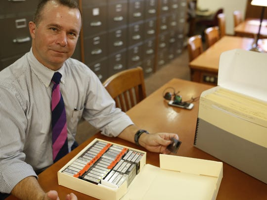 Professor Davis Houck shows off some tapes from a filmmaker's research now housed in the Emmett Till collection in the special collections room at Florida State's Strozier Library.