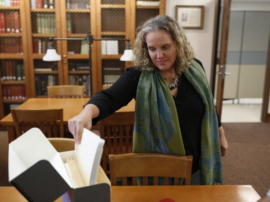 Associate Dean of Libraries for Special Collections at FSU Katie McCormick selects a folder from the Emmett Till collection in the special collections room at Florida State's Strozier Library Nov 13.