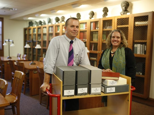 Professor Davis Houck (left) and Associate Dean of Libraries for Special Collections at FSU Katie McCormick pose with some documents from the Emmett Till collection in the special collections room at Florida State's Strozier Library Nov 13.
